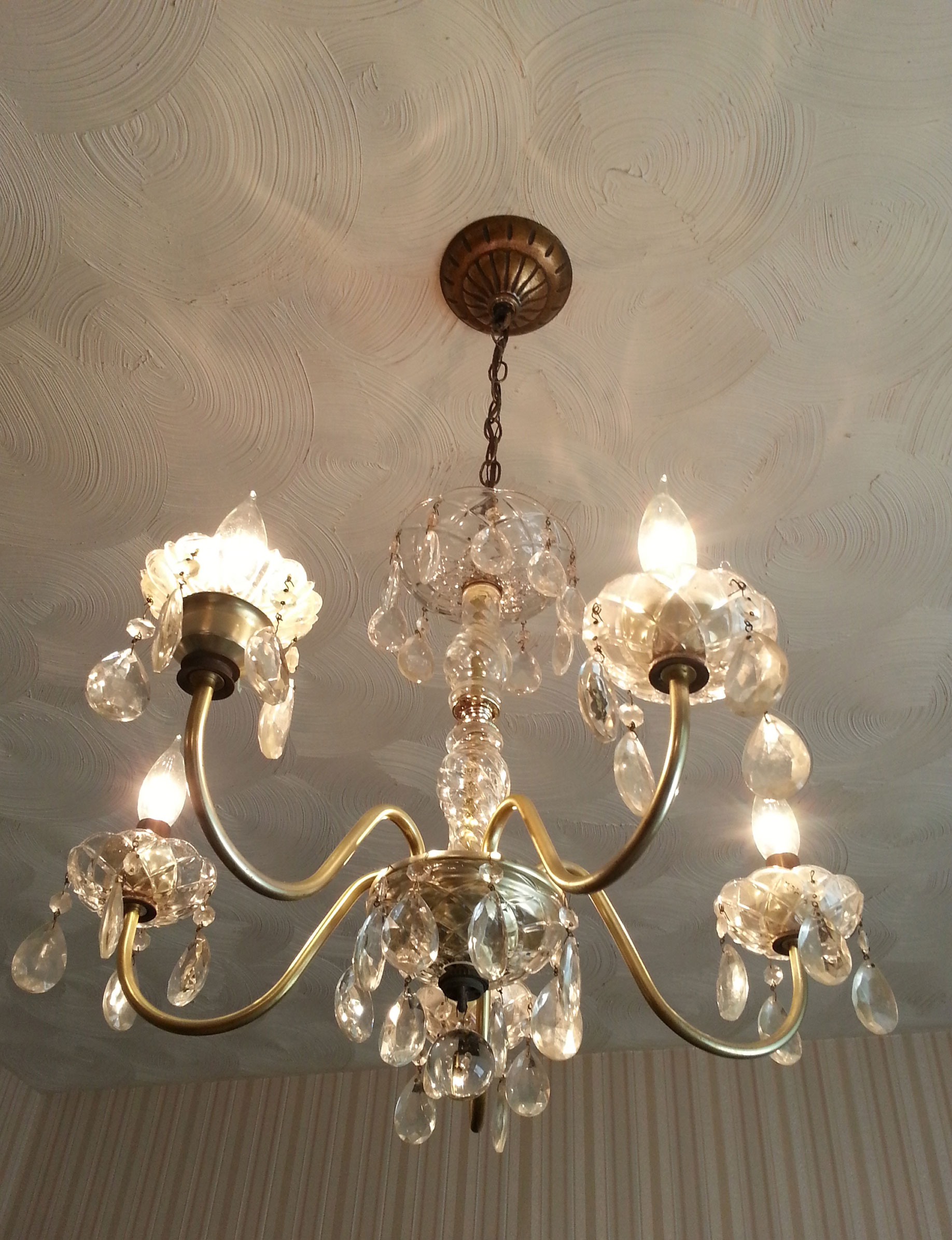 Wendy Wu of Bethesda, Md., figured out how to rewire a chandelier after enrolling in Bill Kinneary's workshop. This single chandelier, now hanging in her dining room, is cobbled together from two purchases she made at Community Forklift.