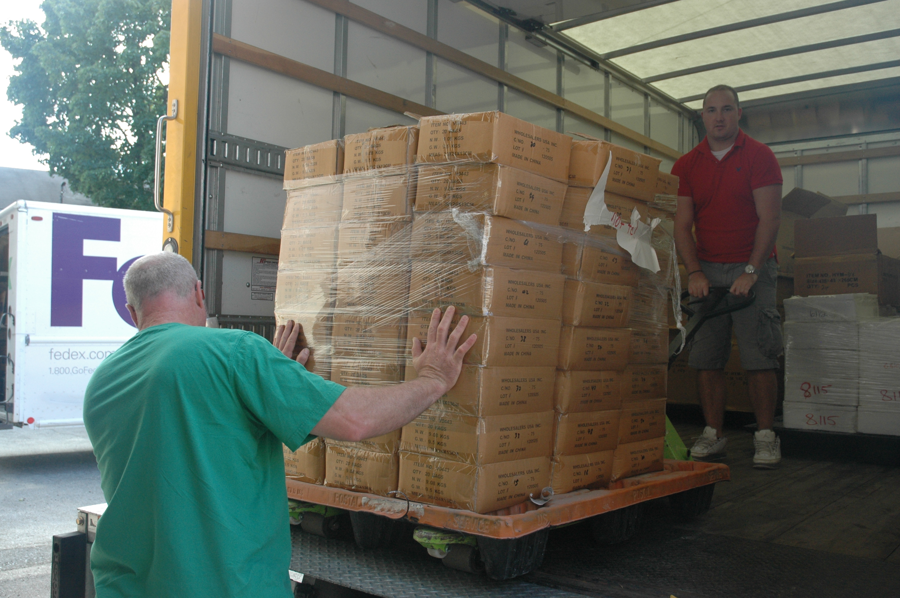 Gary Piscopo, left, and John Gray load a donation from their Frederick, Md.-based company, Wholesalers USA Inc., into a truck headed for the Community Forklift.