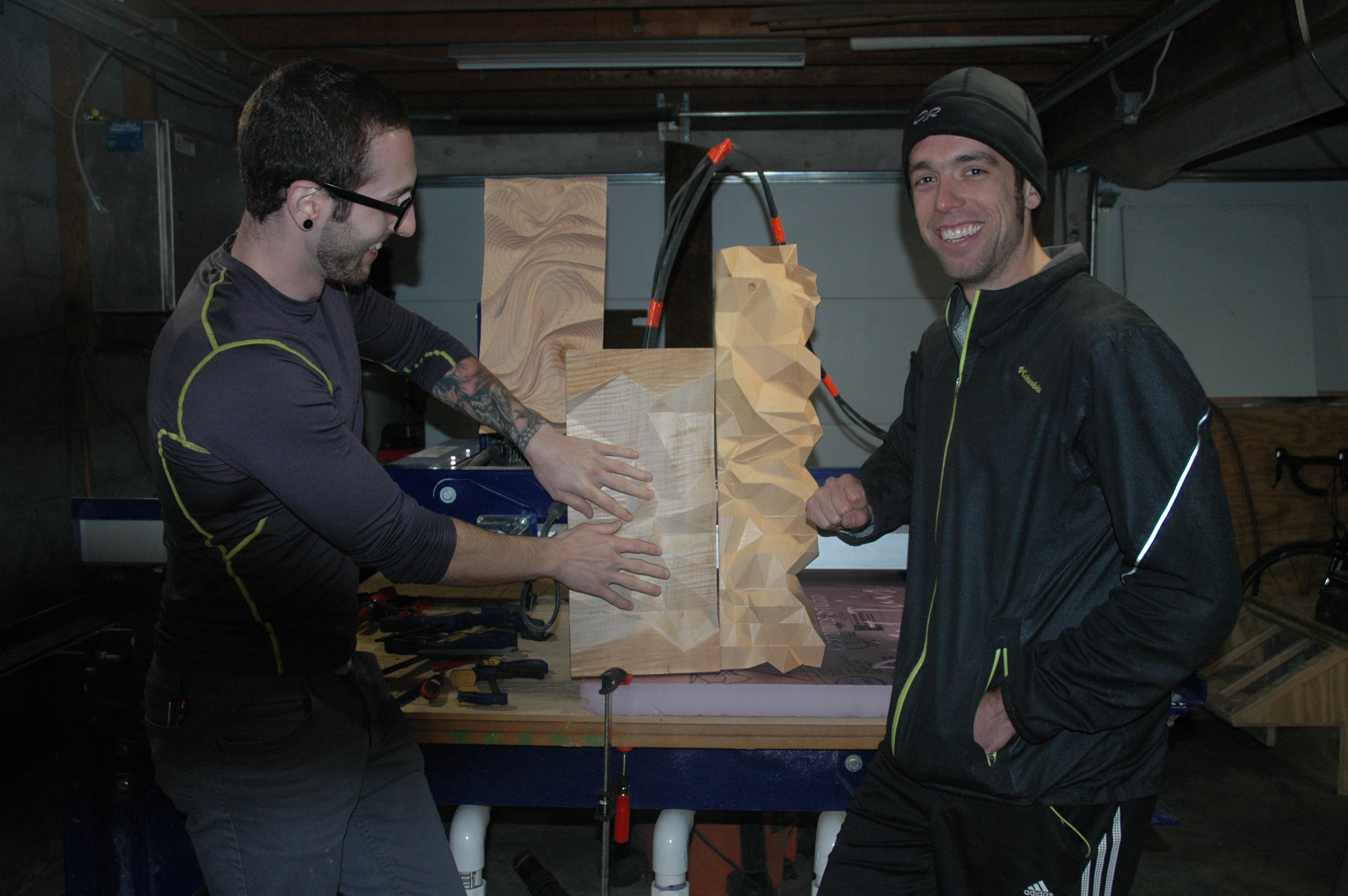 Kyle Bendle, left, and Brad Bolte, who met while studying architecture, use reclaimed wood from Community Forklift to create their unique sculptures.