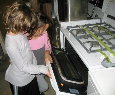Little Forklift Fans inspect the inside of a stove