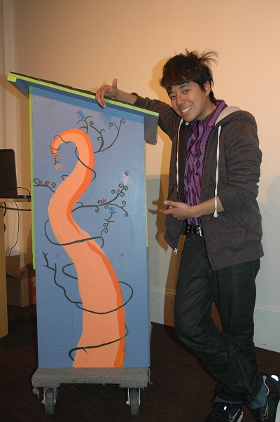 Astra Robles-Gottlieb gestures to her whimsical handiwork on the other side.