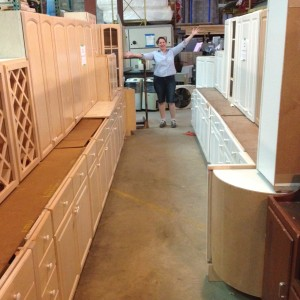 Ruthie showing off cabinet sets