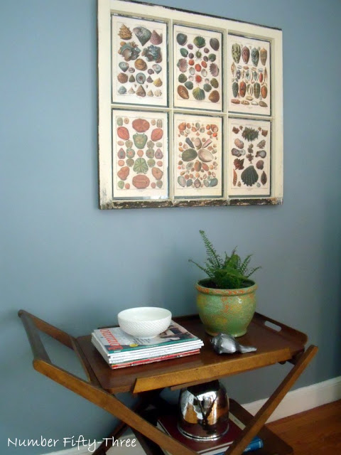 Or use an old sash to frame pictures you love from an old calendar or book (From blogger NumberFiftyThree )