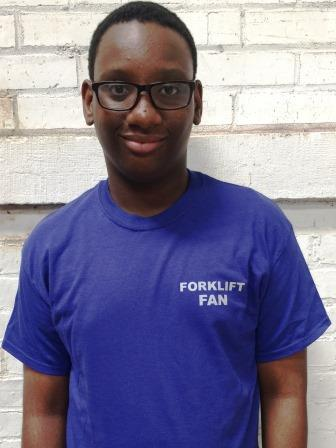 Kendall, one of our Jobs for Youth summer interns, models a crewneck style.
