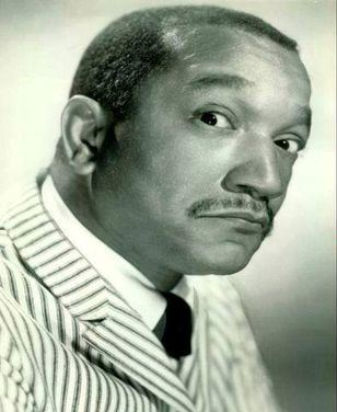 Looking skeptical - Redd Foxx who later played Fred Sanford