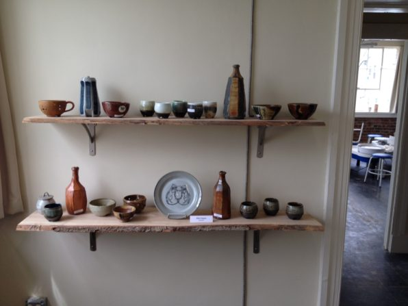 Beautiful live edge shelves at District Clay.