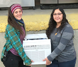 Susana and Jane with Air Conditioner