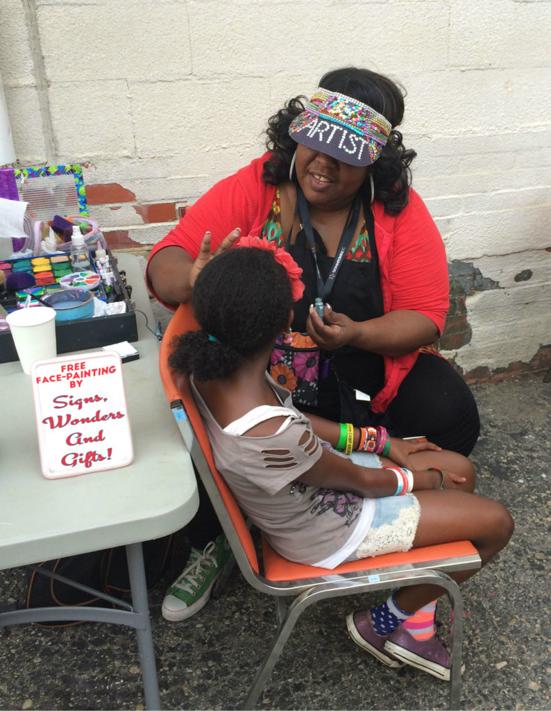 Photo of a girl holding still for the face-painter