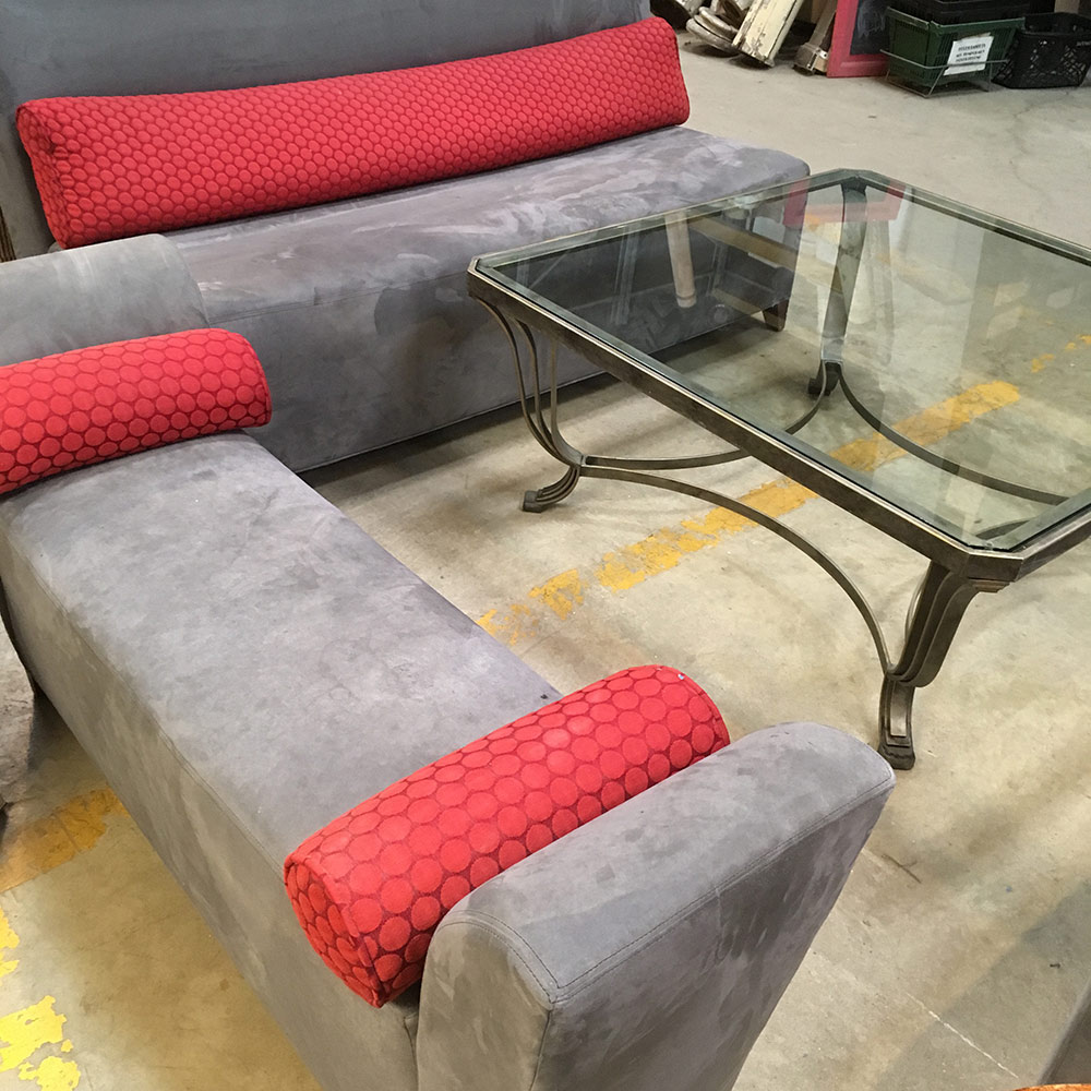 photo of a sofa and bench with a glass coffee table