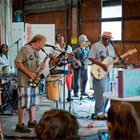 Ron Hicks Project playing in the reuse center